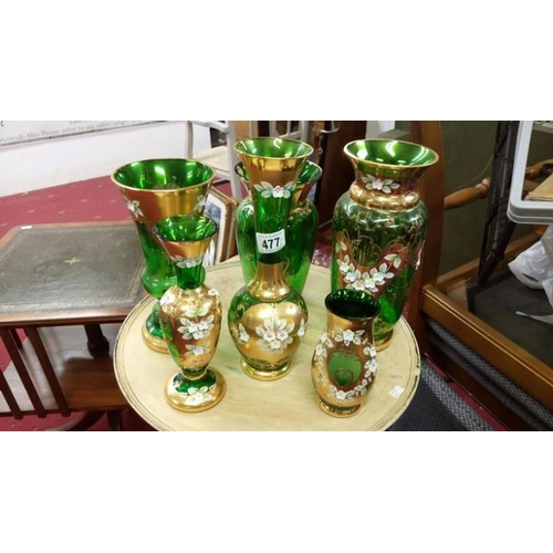 477 - 6 items of green Bohemian glass with gold and enamel decoration...