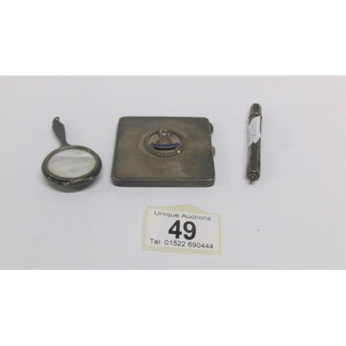 49 - A silver compact, a small silver mirror and a silver pencil...