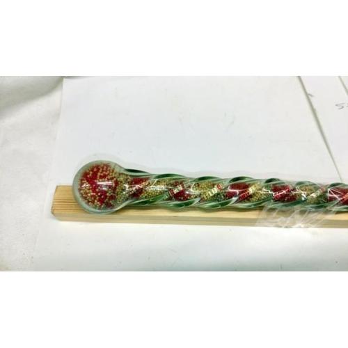494 - A glass sand cane...
