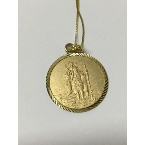 51 - A 9ct gold St. Christopher pendant...