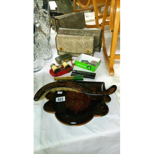 523 - A lacquered crumb tray with brush, a snake skin vanity set and other items...