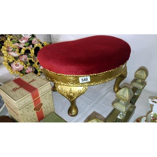 540 - A gilded kidney shaped footstool...