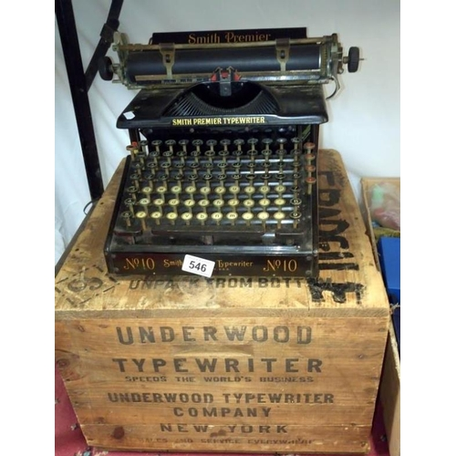 546 - A Smith's premier typewriter with a packing crate marked Underwood...