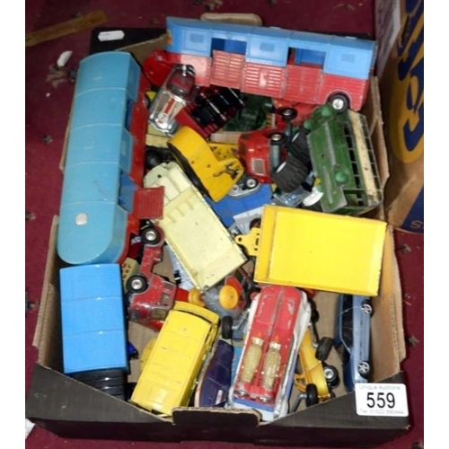 559 - A box of playworn Corgi, Dinky and Tonka vehicles...