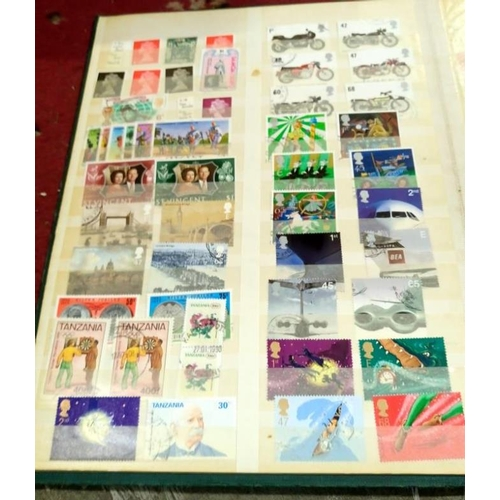 561 - A quantity of stamp albums and stamp catalogues...