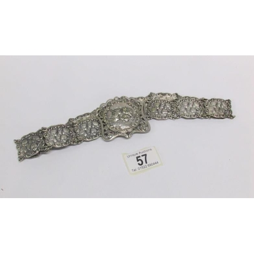 57 - An art nouveau white metal belt...