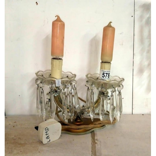 578 - A French double chandelier style table lamp with glass droppers...