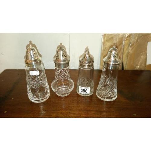 586 - 4 cut crystal sugar casters including 2 Stuart and 1 Edinburgh crystal...