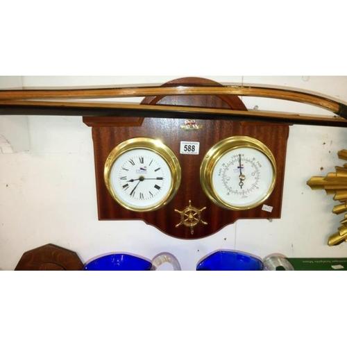 588 - An R.N.L.I clock/barometer...