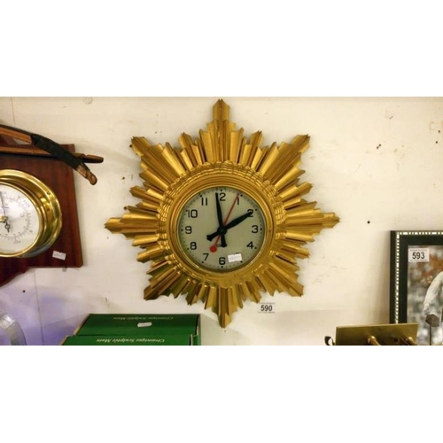 590 - A Gent's of Leicester art deco gold painted wooden clock with electric movement...