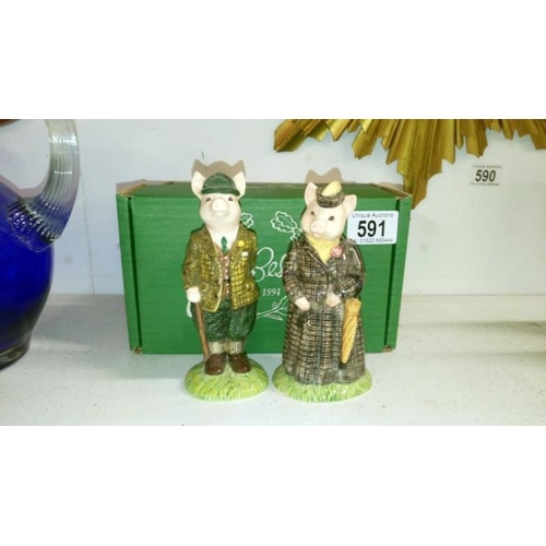 591 - 2 boxed Beswick figurines being Lady Pig and Gentleman Pig...