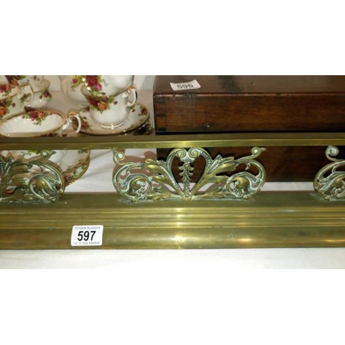 597 - A Victorian brass fender...