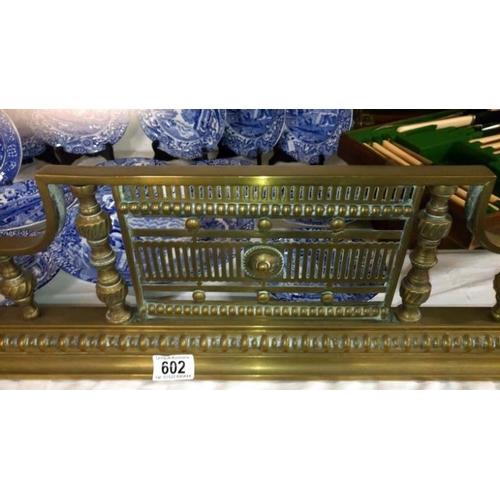 602 - A Victorian brass fender...