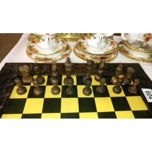604 - A wooden chess set in box and with board...