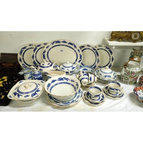605 - A quantity of Royal Cauldon Bristol Ironstone 'Dragon' blue and white dinner and tea ware...