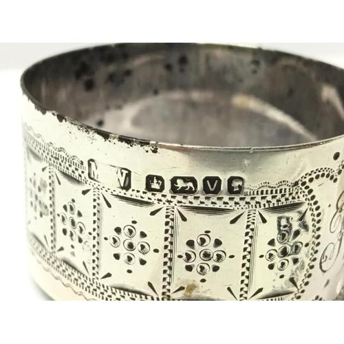 61 - 2 silver napkin rings...