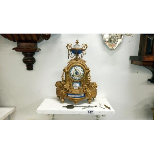 612 - A French gilt mantel clock with enamel dial...