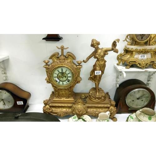 617 - A gilded mantel clock surmounted figure...