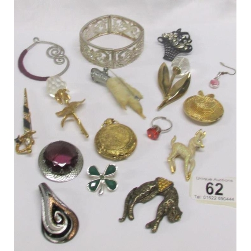 62 - A mixed lot of costume brooches etc...