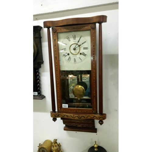 622 - A Victorian inlaid wall clock...