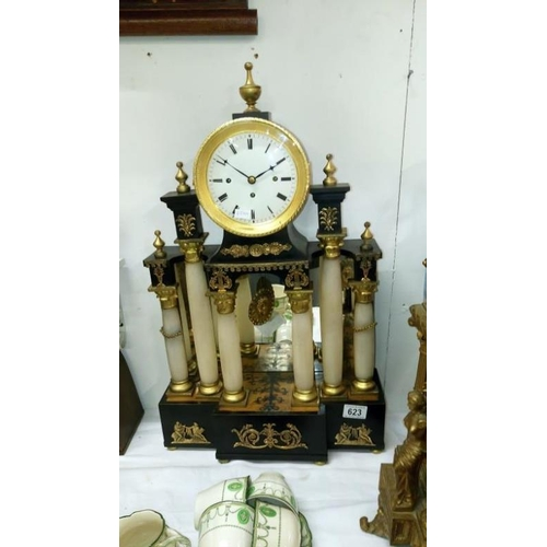 623 - A ornate mantel clock with columns...