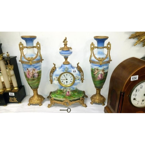626 - A 3 piece ceramic clock set...