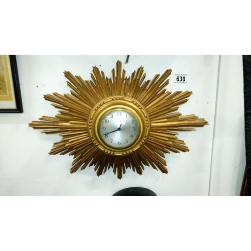 630 - A sunburst wall clock...