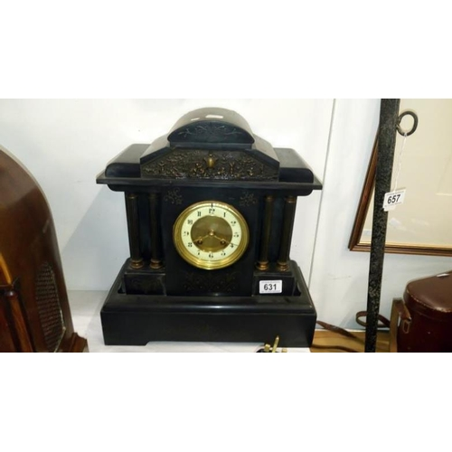 631 - A black slate mantel clock...
