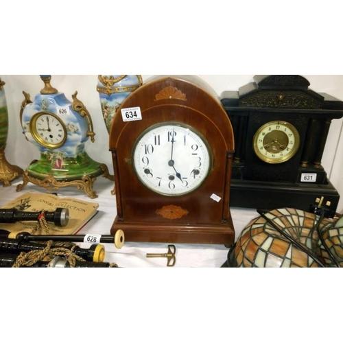 634 - A mahogany inlaid mantel clock...