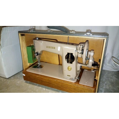 647 - A vintage Singer sewing machine in crocodile skin effect case...