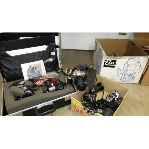 651 - A Canon 35mm and a Nikon 35mm camera, lenses, a Pentax camera, lenses and case...