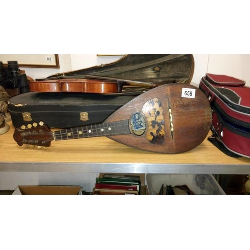 658 - A vintage mandolin by G Puglisi, Reale & Figli together with a quantity of sheet music...