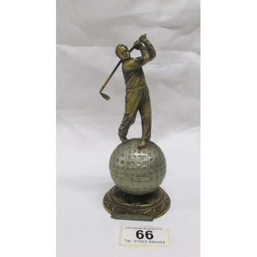 66 - An art deco spelter Lorenzl style striker lighter in the form of a golfer (missing wand)...