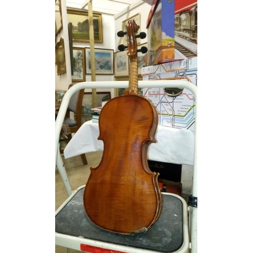 660 - A violin in case...