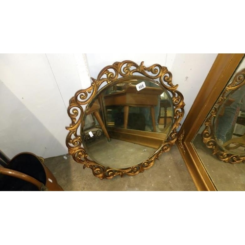 668 - A gilt framed wall mirror...