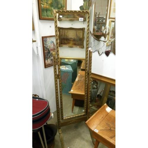 670 - A gilt framed cheval mirror...
