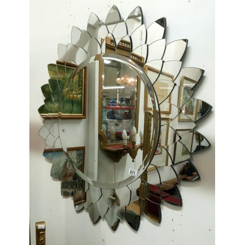 671 - A decorative wall mirror...
