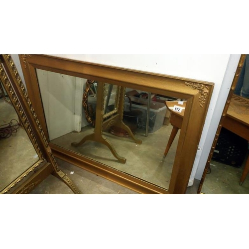 672 - A large framed mirror...
