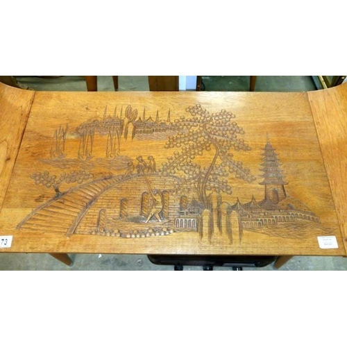 673 - A carved top coffee table...