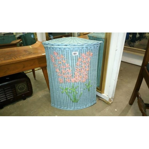 681 - A painted wicker linen bin...