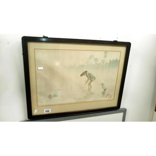 696 - A lovely Asian water colour of a girl planting rice, signed and in original frame...