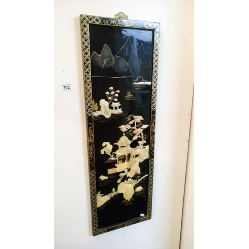 702 - An oriental lacquered wall hanging...