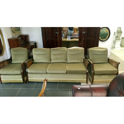 704 - A Bergere 3 piece suite with green upholstery...