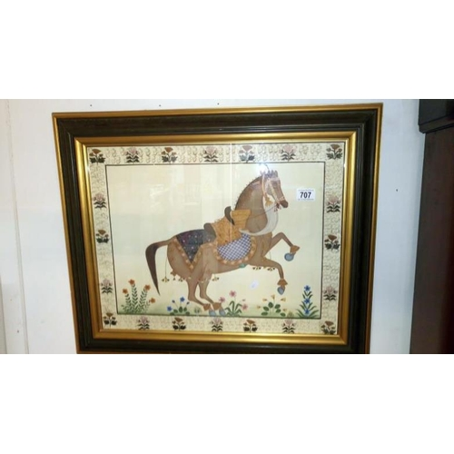 707 - A framed and glazed fabric picture of a horse...