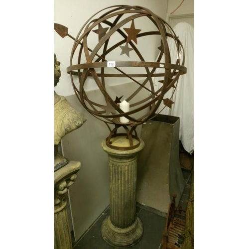 714 - A large steel armillary globe on reeded churchstone column...