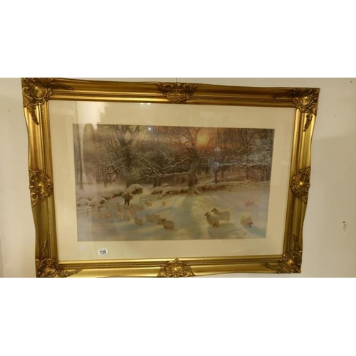 720 - A gilt framed and glazed print of sheep in winter landscape...