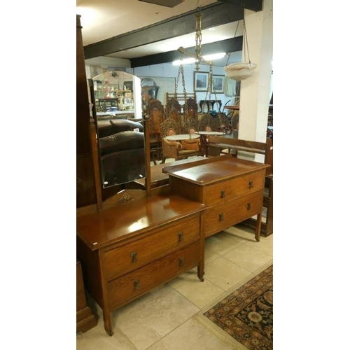 724 - A 1930's oak dressing table and 2 drawer chest...