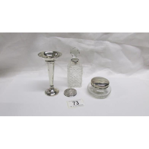 73 - A silver rimmed scent bottle, a silver topped pot and 2 other silver items...