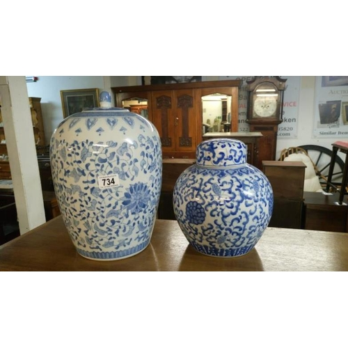 734 - 2 large blue and white lidded jars...