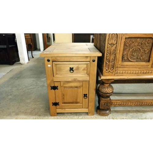 735 - A pair of pine bedside cabinets...
